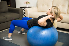 Woman doing crunches on a stability ball Royalty Free Stock Photography