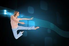 Woman doing dance pose Stock Photos