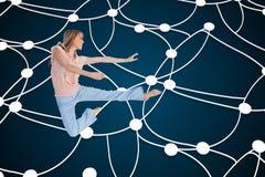 Woman doing dance pose Stock Image