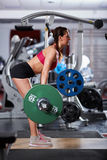 Woman doing deadlift with barbell Royalty Free Stock Photography