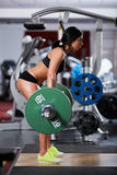 Woman doing deadlift with barbell Stock Images