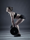 Woman doing deadlift Royalty Free Stock Photos