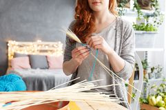 Woman doing decoration. Artistic woman doing decoration in her creative space Stock Images