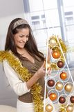 Woman doing design christmas decoration Stock Photos