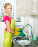 Woman doing dishes at home Stock Photos
