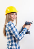 Woman doing the DIY work and wearing protective helmet Royalty Free Stock Photography