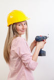 Woman doing the DIY work and wearing protective helmet Royalty Free Stock Image