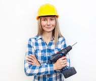 Woman doing the DIY work and wearing protective helmet Royalty Free Stock Photo