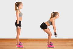 Woman Doing Dumbbell Deadlift Royalty Free Stock Photography