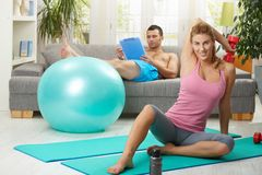 Woman doing dumbbell exercise Stock Photos