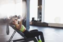 Woman doing dumbbell flyes royalty free stock photo