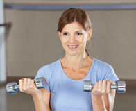 Woman doing dumbbell training Royalty Free Stock Images