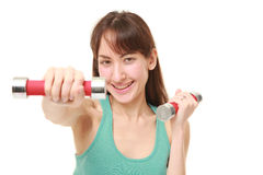 Woman doing dumbbll exercise Royalty Free Stock Image