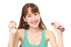 Woman doing dumbbll exercise Stock Photo