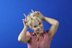 Woman doing ears with her fingers Royalty Free Stock Image