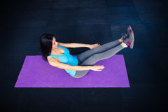 Woman doing excercise on yoga mat Royalty Free Stock Images