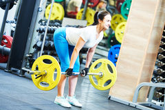Woman doing exercise for back muscles Stock Photos