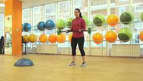 Woman doing exercise with barbell stock video footage