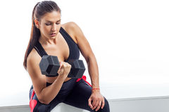 Woman doing an exercise on the biceps royalty free stock photos