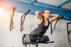 Fitness woman doing exercise for buttocks on bench. Woman doing exercise for buttocks on bench Royalty Free Stock Photo