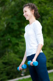 Woman doing  exercise with dumbbell Royalty Free Stock Image