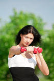 Woman doing exercise with dumbbell royalty free stock photo