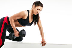 Woman doing an exercise with a dumbbell royalty free stock photo