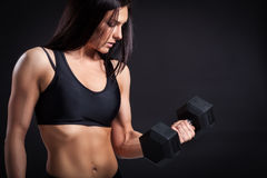 Woman doing an exercise with a dumbbell royalty free stock images