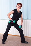 Woman doing exercise with dumbbells Royalty Free Stock Images