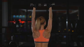 Woman doing exercise with dumbbells on shoulders stock video