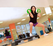 Woman doing exercise with dumbbells Royalty Free Stock Photography