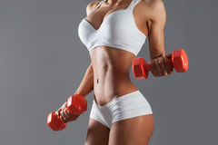 Woman doing exercise with dumbells Stock Images
