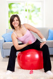 Woman doing exercise on fit ball Royalty Free Stock Image