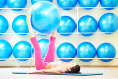 Woman doing exercise with fitness ball Stock Photos
