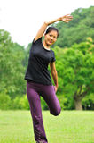 Woman doing exercise in garden Royalty Free Stock Image