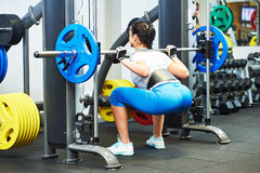 Woman doing exercise in gym Royalty Free Stock Photo