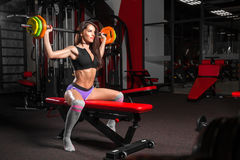 Woman doing exercise in the gym royalty free stock images
