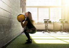 Woman doing exercise with heavy medicine ball in gym Stock Photos
