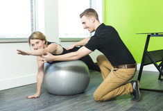 Woman doing exercise with large ball Royalty Free Stock Photos