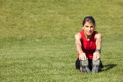 Woman doing exercise outdoor Royalty Free Stock Photo