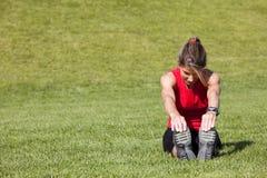 Woman doing exercise outdoor Stock Photos