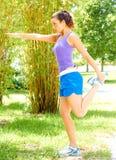 Woman Doing Exercise At Park Stock Photos