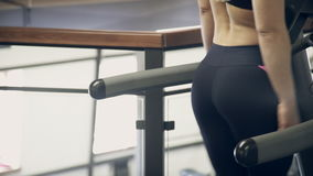 Woman doing exercise Runs on treadmill in fitness studio stock footage