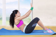 Woman doing exercise and sit up at home Royalty Free Stock Image