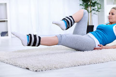 Woman doing exercise for strengthening legs Royalty Free Stock Image