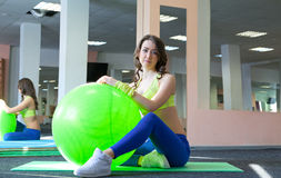 woman doing exercise and stretching on a fitness ball Stock Photos