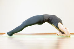 Woman doing exercise of yoga indoor Royalty Free Stock Photos