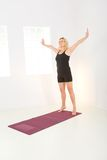 Woman doing exercises. Elder woman dressed sportswear working out royalty free stock image
