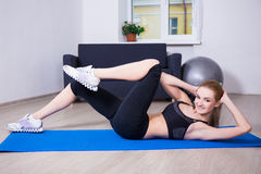 Woman doing exercises for abdominal muscles Stock Image