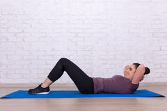 Woman doing exercises for abdominal muscles Stock Images